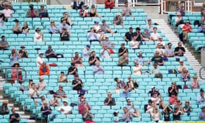 Spectators observing social distancing in the stands during a friendly match at the Oval, London in August.