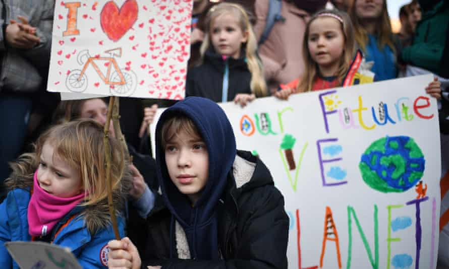 Schoolchildren take part in a nationwide student climate march in George Square on February 15, 2019 in Glasgow.