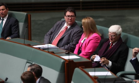 George Christensen crosses the floor on Tuesday evening to vote with Labor and the independents on amendments that would maintain penalty rates.