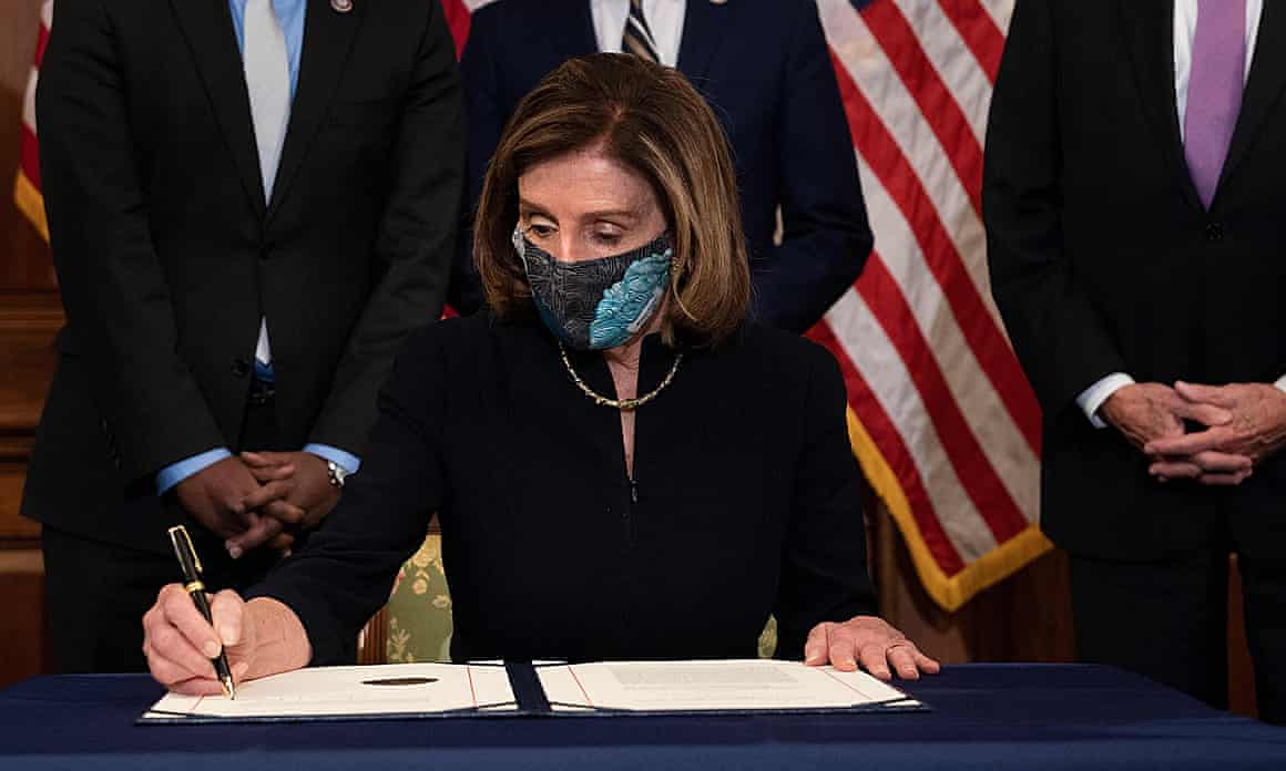 House speaker Nancy Pelosi signs the article of impeachment condemning Donald Trump for 'inciting insurrection'