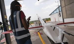 A worker prepares a Zipline medical delivery drone