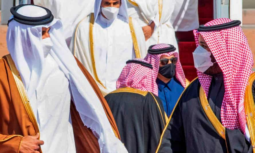 Crown Prince Mohammed bin Salman (right) welcomes Emir of Qatar Tamim bin Hamad Al-Thani at the airport in Al-Ula, Saudi Arabia.
