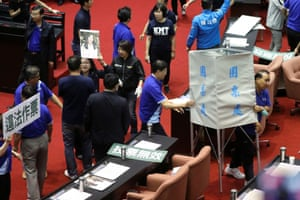 Several KMT lawmakers knocked down voting booths to block DPP legislators from casting ballots over the nomination