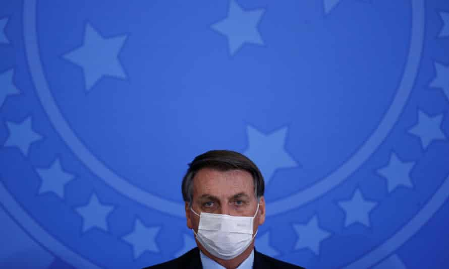 Brazil's President Jair Bolsonaro looks on during an inauguration ceremony of the new Communications Minister Fabio Faria (not pictured) at the Planalto Palace, in Brasilia<br>Brazil's President Jair Bolsonaro wearing a protective face mask looks on during an inauguration ceremony of the new Communications Minister Fabio Faria (not pictured) at the Planalto Palace, in Brasilia, Brazil June 17, 2020. REUTERS/Adriano Machado