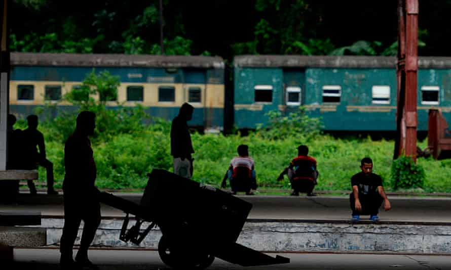 A railway worker pushes a cart at a station in Dhaka after the resumption of all train passenger services in Bangladesh.