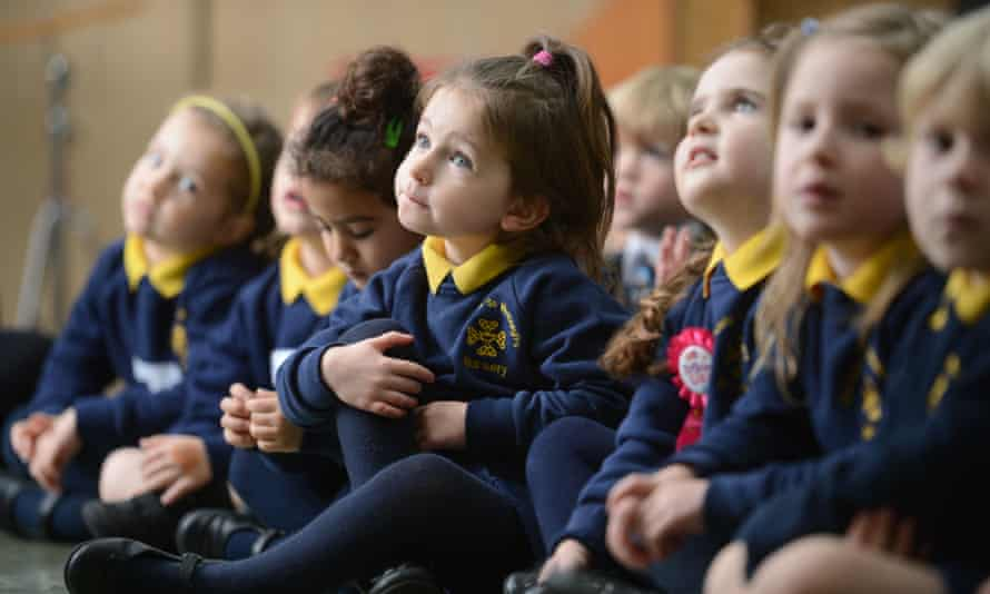 Children in morning assembly at a Catholic primary school in Newcastle-under-Lyme, Staffordshire.