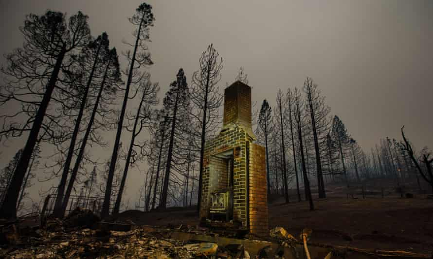 The smoldering remains of a structure where the Creek fire tore through in Fresno county, California.