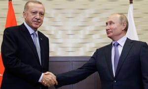Recep Tayyip Erdoğan (left) is greeted by Vladimir Putin before their meeting in Sochi, Russia