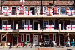 London, UKEngland flags fly from flats on the Kirby Estate in Bermondsey, ahead of Euro 2020 soccer tournament