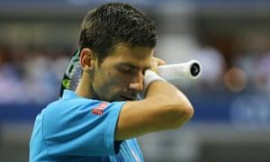 Novak Djokovic looks downcast after losing the third set.