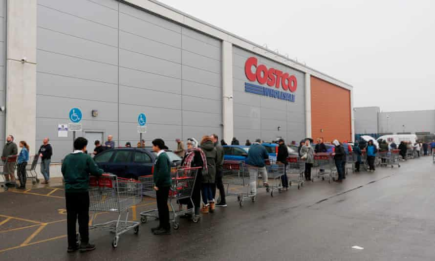 People queue up outside a Costco wholesale outlet in Farnborough.
