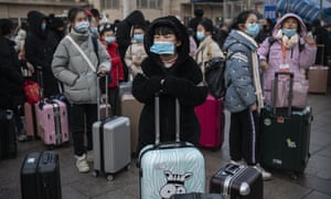 Travellers at Beijing railway station on Wednesday