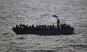 Migrants wave for help from a wooden boat 21 miles north of the Libyan coast. European countries have shown little appetite for drawing up a united strategy.