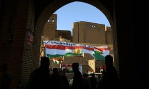 Giant Kurdish flags adorn the hill of Erbil citadel, in the capital of the autonomous Kurdish region of northern Iraq.