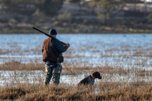 A hunter with his dog at Little Lake Buloke just after the opening of hunting season