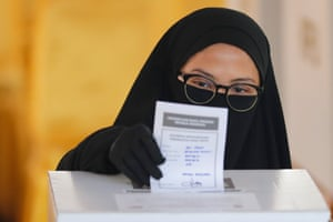 An Indonesian woman casts her vote during the general election at a polling station in Jakarta. More than 192 million Indonesians cast their votes to elect the president, vice president and members of the House of Representatives as well as Regional Representative Council.