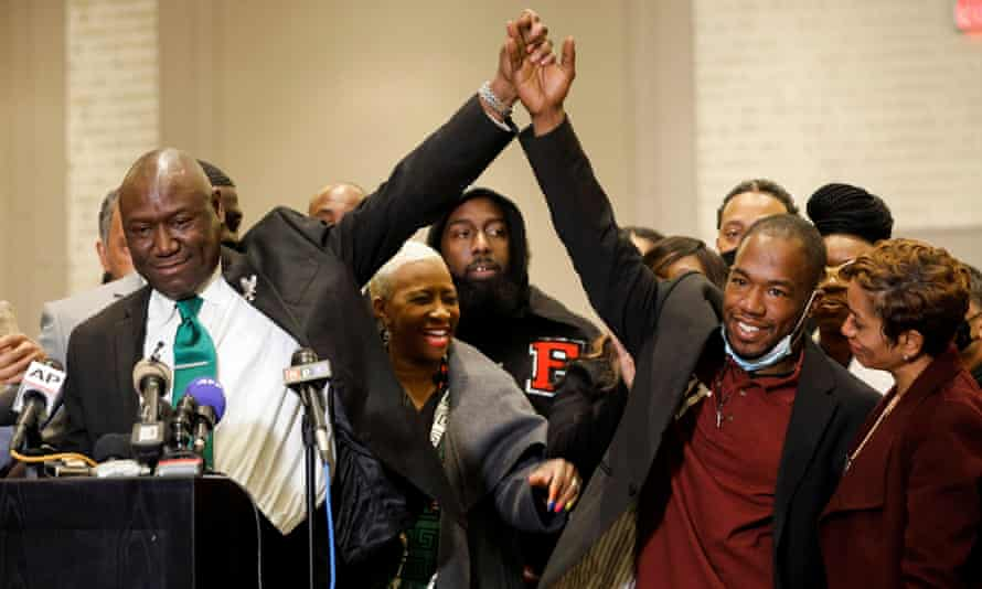 George Floyd family attorney Ben Crump (left)  holds hands with Donald Williams following the verdict in the trial of former Minneapolis police officer Derek Chauvin