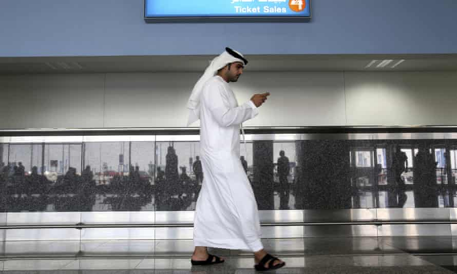 A man uses his phone at the airport in Dubai, United Arab Emirates.
