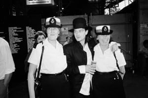 Bono with two officers
