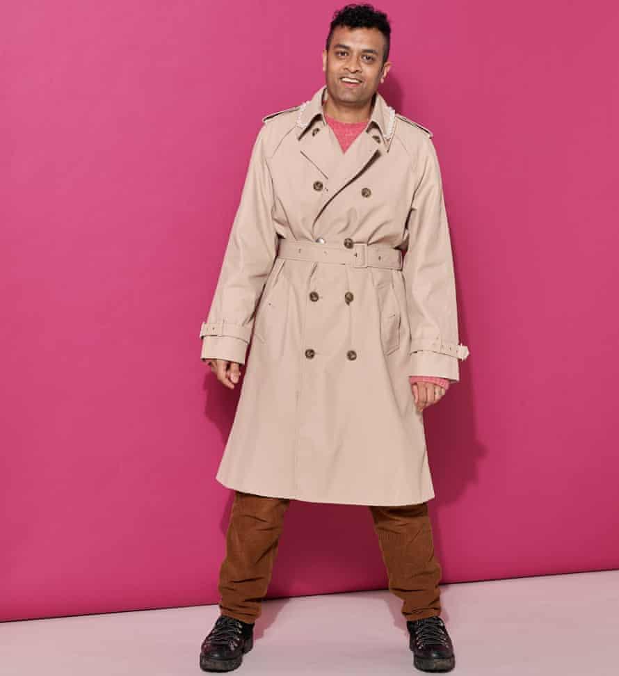Priya Elan in trench coat