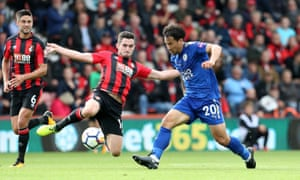 Leicester's Shinji Okazaki and Bournemouth's Lewis Cook challenge for the ball.