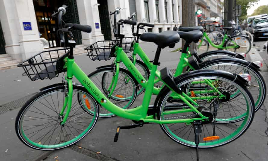 """Several """"Gobee.bike"""" bicycles, a city bike-sharing service, are seen on a sidewalk in Paris"""