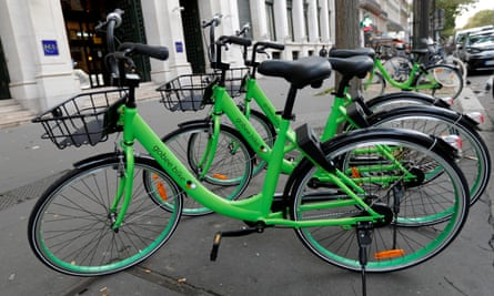 "Several ""Gobee.bike"" bicycles, a city bike-sharing service, are seen on a sidewalk in Paris"