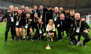 Liverpool manager Jurgen Klopp and the rest of the Melwood staff celebrate with the Club World Cup trophy after their victory over Flamengo in December 2019.