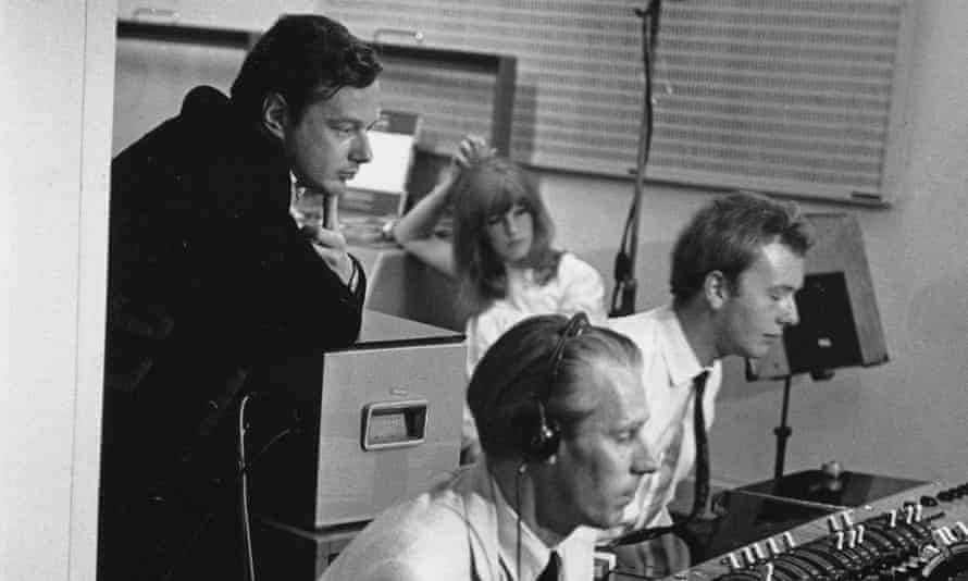From left, Brian Epstein, George Martin and Geoff Emerick recording the Beatles at Abbey Road studios in 1967.