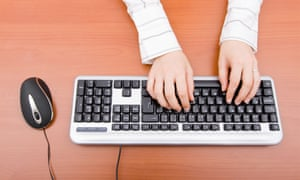 woman using PC keyboard