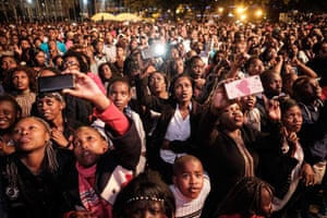 People wait for a moment to count down to New Year during the New Year's music event at Kenyatta International Convention Centre (KICC) in Nairobi, Kenya