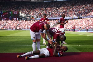 Michail Antonio takes a lie down on the new stadium carpet after opening the scoring.