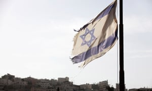 An Israel flag flies near a Jewish settlement in Hebron. A Human Rights Watch representative has been given two weeks to leave Israel.