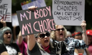 Pro-choice campaigners in Texas on Tuesday. Critics called the bill's passage 'shameful' and noted it does not make exceptions for victims of race or incest.
