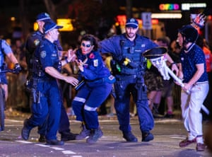 Police clash with protestors attempting to block the Liberal Party float