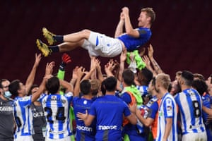 Real Sociedad's David Zurutuza is thrown into the air by his teammates after the match against Atletico Madrid.