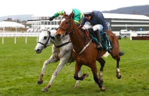 Colreevy ridden by Paul Townend (R) competes against Elimay ridden by Mark Walsh (L)