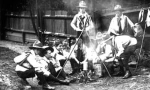 A group of Boy Scouts sitting around a camp fire, 1910.