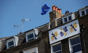 A European Union flag flies and a Vote European Election sign hangs from a house in south London