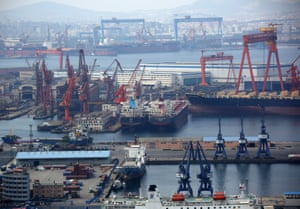 Tankers are moored at the port of Dalian in Dalian, China.