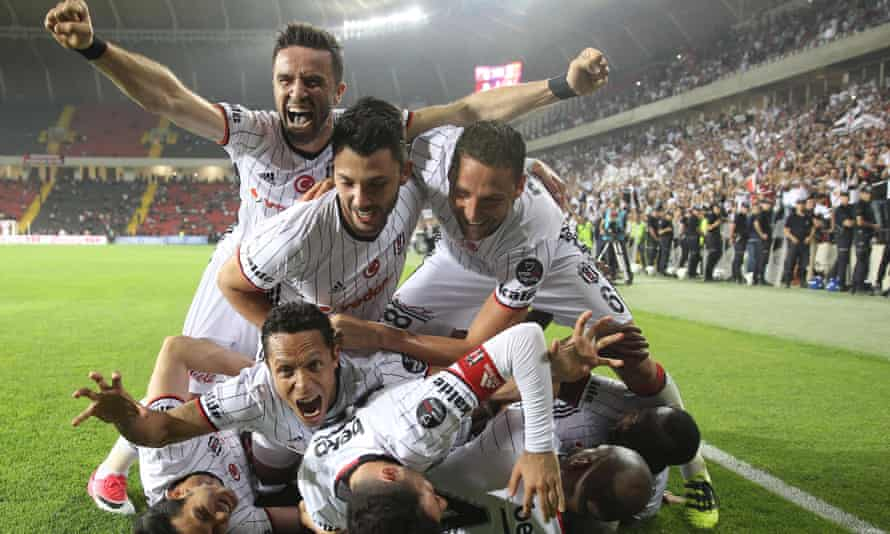Besiktas's players celebrate winning the Super Lig championship in May 2017