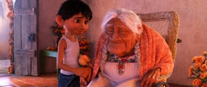 Miguel, voiced Anthony Gonzalez, with his great-great-grandmother, Mamá Coco (Ana Ofelia Murguía) in Coco.