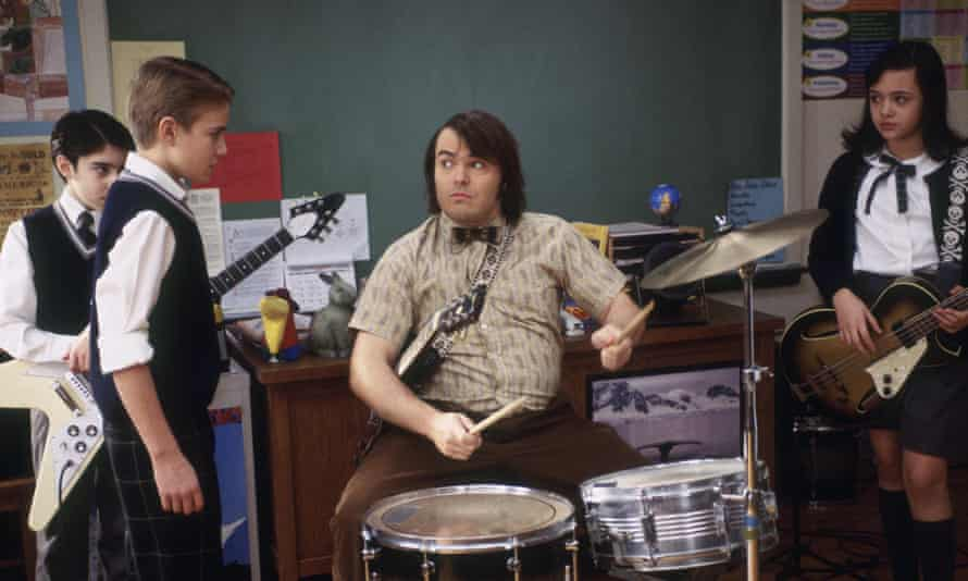 'he loved music' … Kevin Clark, second left, gets a drumming lesson from Jack Black in School of Rock.