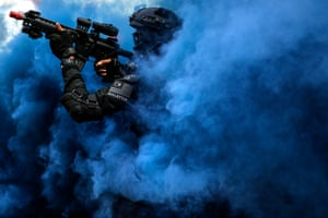 Kuala Lumpur, Malaysia A member of the Royal Malaysian Police Special Tactical Unit takes part in a security drill simulating rescue of hostages in preparation for the upcoming South East Asian Games