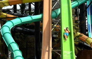 Valencia, USPeople enjoy the rides at Six Flags Hurricane Harbor water park in Valencia during California reopening day