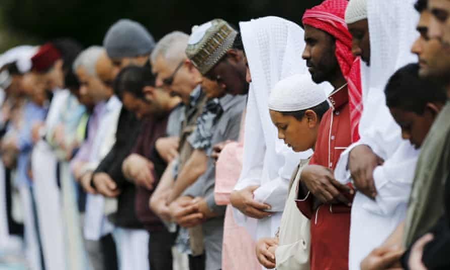 Muslims perform Eid prayers in a London park