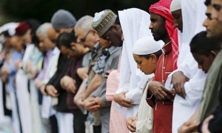 Muslims pray for Eid-al Fitr at a park in London