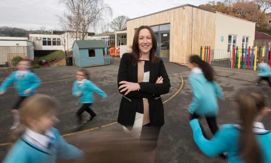 Lorraine Clarke in playground with children