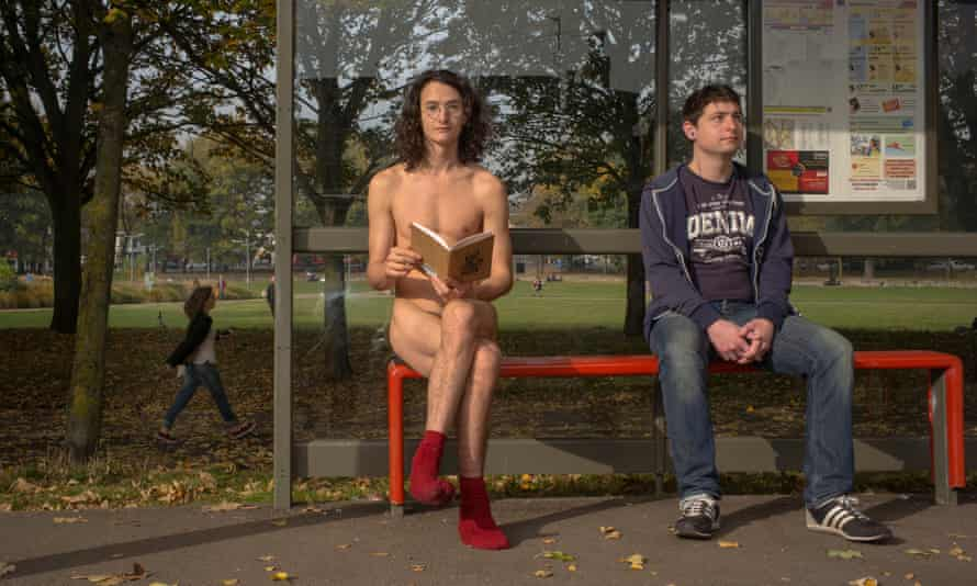 Charlie Gilmour, naked, waiting for a bus