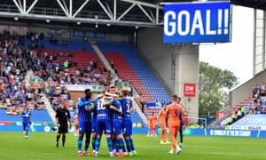 Wigan Athletic's Josh Windass celebrates scoring his side's second goal against Cardiff.